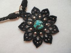 Turquoise crimped in This elegant Mandala Macrame necklace whit sylver!