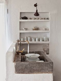 Plaster shelves and stone sink in this very chic minimal modern farmhouse style kitchen.