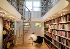 Two levelled library with spiral staircase. Creative Home Library Designs For a Unique Atmosphere