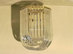 Mid Century Modern Lucite Ribbon Chandelier by PurchasePast, $596.00