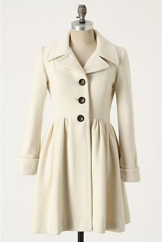 Winter white coats are so beautiful.  You can wear them with black or brown!
