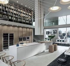 White, grey and natural wood. Upper floor library wall.  Wishbone chairs - modern - eclectic