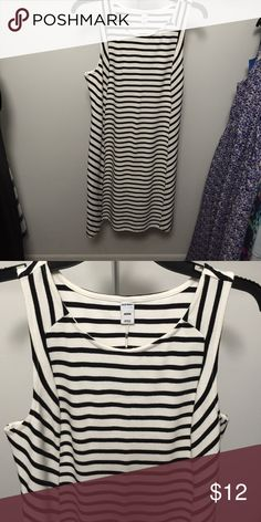 Old Navy black and white striped dress Casual, comfy and cute!!  This dress is super versatile - can be worn to work with a black blazer and heels or paired with a jean jacket for a casual date or girls night.  You will get lots of use out of this dress! Old Navy Dresses Midi