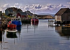 """Peggy's Cove by Kathy Weaver  Boats in a small harbor at Peggy""""s Cove, Nova Scotia in Canada."""