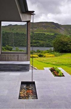 Living House Plan Embraces Ireland Landscape Inverted roof with pull chain to harvest rainwater.Inverted roof with pull chain to harvest rainwater. Outdoor Gardens, Indoor Outdoor, Outdoor Living, Small Gardens, Rain Garden Design, Ways To Save Water, Casa Patio, Ireland Landscape, Architecture Details