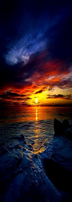 Daybreak - Sunrise over Lake Michigan at 0 degrees and minus 25 windchill, USA by Phil Koch