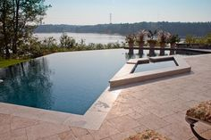 Interesting angled vanishing pool with spa, from Northern Pool and Spa