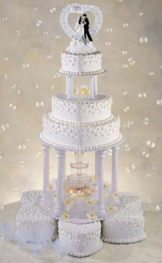Michaels.com Wedding Department: The Love Keeps Flowing This spectacular wedding cake will be the crowing glory of your reception. Courtesy of Wilton Industries, Inc.