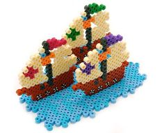 Columbus sailed the ocean blue in fourteen hundred and ninety-two! Here are his three ships—the Nina, the Pinta, and the Santa Maria—for you to create from Perler beads in honor of Columbus Day.