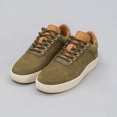 97cafd093 Low-top sneaker with an upper constructed from olive suede. Natural cow  lining and