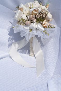 Off White Seashell Ribbon Sandollar And Sobe Pearl Flower Bouquet