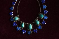 1920 Egyptian scarab necklace & 1930's Czech blue glass necklace