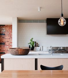 Modern kitchen with a warehouse aesthetic.  Clare Cousins Fitzroy