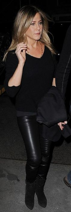 Who made Jennifer Aniston's black suede boots and handbag?