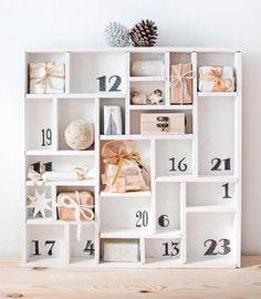 This would be cute to fill with little doll clothes/pieces of outfits for a little girl to open! Woodland Christmas, Christmas Mood, Noel Christmas, All Things Christmas, Advent Calenders, Diy Advent Calendar, Advent House, Christmas Crafts, Christmas Decorations