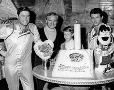 """Lost in Space cast celebrating Dr Smith's birthday. Cake appears to be a toilet seat with Harris' face peaking through. Reads, """"Through this hole have come some of the biggest stars. Happy Birthday"""""""