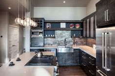 Small contemporary kitchen with dark cabinets light countertops and porcelain tile backsplash