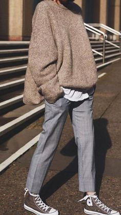 Cozy oversized taupe sweater over white tee and gray checked pants.