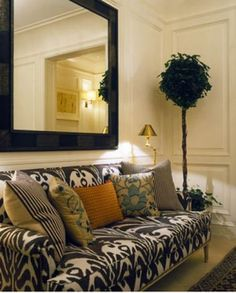 ikat Victorian Sofa | This statement sofa mixes patterns like a pro - Ikat and stripes are a ...