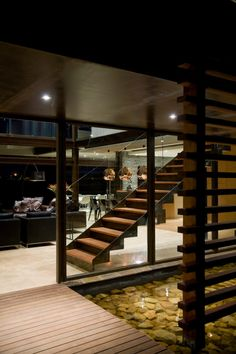 koi pond entrance \\\ House Serengeti by Nico van der Meulen Architects