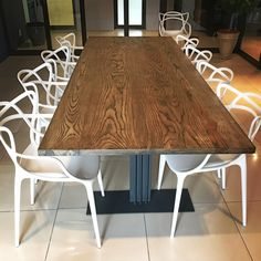 10 seater, American ash table top treated with a chocolate mono coat mounted on a charcoal ferrograin powder coated industrial steel base. Hand made in Johannesburg, South Africa. By the Craste Space team