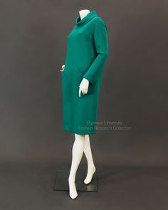Viridian green wool day dress with cowl neck, raglan sleeves, decorative top stitching and front pocket detail, size 12. c.1966-1970. Label: JEAN PATOU PARIS, Made in France for Holt Renfrew. FRC1997.04.020