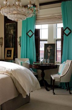 Turquoise curtains accent this bedroom along with a headboard wall, love the holdbacks (view 2 of 2)