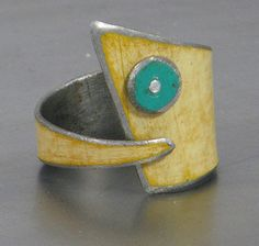 ring using metal salvaged from a yellow 78 Ford pickup