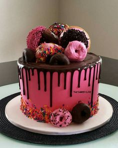 Hot pink and chocolate donut drip cake