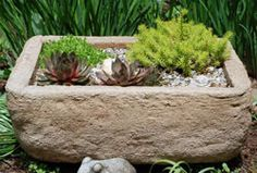 Great article on how to make hypertufa, using peat moss, perlite, sand, and portland cement.