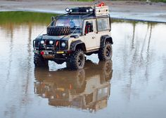 Defender D90 based on a Axial SCX10 Chassis.  Build by Rc Car & Bodyshop