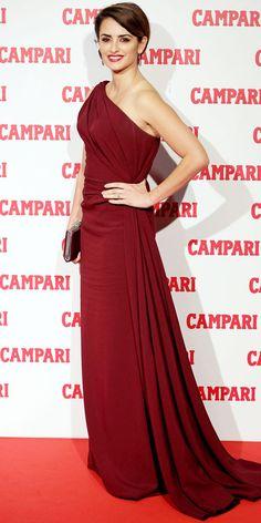 Cruz unveiled the Campari calendar in a head-to-toe burgundy look that included a custom Giorgio Armani gown and teardrop earrings.