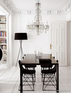 Crystal chandelier in this white dining room is chic. Dark chairs contrast in the otherwise all white dining room. Dining Room Inspiration, Interior Design Inspiration, Interior Ideas, Modern Interior, Modern Decor, Black And White Dining Room, Black White, Black Neon, White Wooden Floor