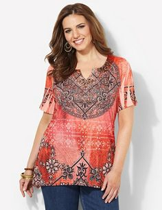 Bold beauty exudes from our latest, must-try top. A silky satin trim accents the notch neckline. Mystical print features a medallion design at the center with a colorful rhinestone edge. Short sleeves have cascading, intricate folds. Complete with an asymmetrical hem that falls longer on each side. Catherines tops are perfectly proportioned for the plus size woman. catherines.com