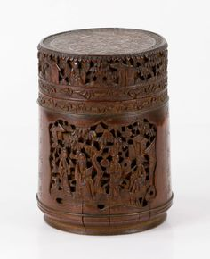 "Chinese bamboo carved tea caddy, with cover, decorated with scholars in garden scene and Chinese poems, 6 1/4"" h x 4 1/2"" dia. Provenance: From a Beverly, Massachusetts collection."