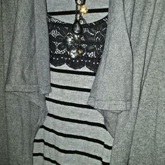 ⬇PRICE⬇NWOT Land's End Gray Cardigan NWOT Gorgeous Land's End Cardigan with eyelet clasp or great left open. Collar has a ruffle edge and gives it a unique vibe. Goes with anything and a staple for Fall and Winter wardrobe. 95% cotton and 5% cashmere.  Dry clean or hand wash, flat to dry, light stream if needed. Lands' End Sweaters Cardigans