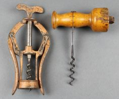 Lot 202, A 19th Century James Healey & Sons A1 double action corkscrew and a 19th Century corkscrew with turned wooden handle (some damage to the side), est £80-120
