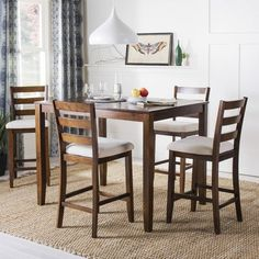 Constructed of durable wood, the Melvin Pub Dining Set from Safavieh offers classic tavern style that is a perfect match for your eat-in kitchen or a casual dining room. Includes 1 pub height table and 4 coordinating upholstered chairs. Pub Dining Set, Kitchen Dining Sets, Pub Table Sets, Pub Set, Counter Height Dining Sets, 5 Piece Dining Set, Dining Room Table, A Table, Dining Rooms