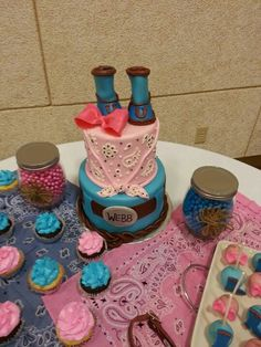Boots and bows baby reveal cake, cupcakes, and cake pops made by Tootsweets Cupcakery