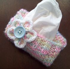 Free Knitting Pattern for Sweater for Purse Tissue Packets - Fasty, easy pattern for small cozy to hold purse-sized tissue packets. Great for stash busting, stocking stuffers, and fundraisers. Project by breet who added a flower.