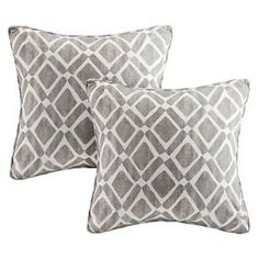 This textured diamond motif square pillow is the perfect solution to add just a touch of fresh color to your room. The printed cotton blend twill has a natural appeal combined with polyester filling for comfort and easy care. Features self-piping trim and comes in a pair.
