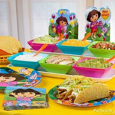 Dora Party Food - love the use of the brightly coloured bowls which match the theme colours to serve the food