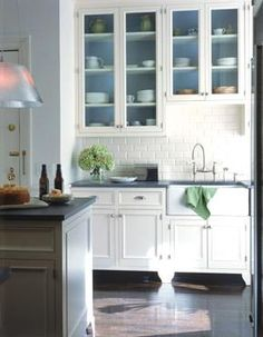 Glass cabinets, white subways tile, beautiful cabinets... what's not to love?!