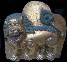 17th century, Tibet, snow lion, fire-gilt copper repoussé and pigment, private collection