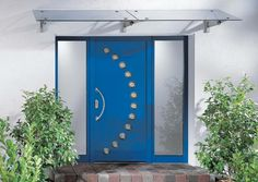 Exterior Exterior Front Door Designs for A Perfect Outer Look: Blade Of Ray Exterior Front Door Design Inspiration With Light Blue Glossy Single Door Plus Curvy Spotlight Decoration And Nickel Top Shade Also Concrete Stone Block