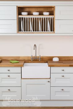 To create a farmhouse kitchen, the devil is in the details. Consider our oak plate racks, traditional cabinet frontals and worktops constructed from a conventional timber, such as oak, walnut or cherry with matching upstands. Kitchen Cabinets Showroom, Stock Kitchen Cabinets, Solid Wood Kitchen Cabinets, Solid Wood Kitchens, Oak Kitchens, Walnut Kitchen, Country Kitchens, Kitchen Worktop, Kitchen Sinks