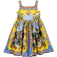 Girls yellow and blue cotton poplin dress by Dolce & Gabbana. This beautiful print of the town of Taormina in Sicily forms part of the designer's 'Carretto Siciliano' collection. Made in lightweight poplin, the style is sleeveless, with a fitted, lined bodice and a full, gathered skirt. It does up at the back with a concealed zip.