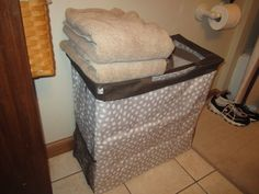whites/darks hamper which just happens to be the room for 2 and a top a tote place clean towels ready for the shower!!