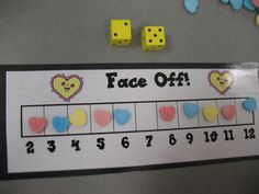 """Face Off"" addition game - Kids roll 2 dice and get to eat the candy heart that is on the sum.  (Free idea from Mrs. Morrow's Kindergarten.)"