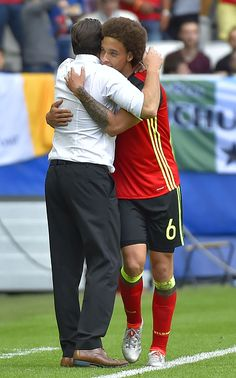 Belgium's midfielder Axel Witsel celebrates with Belgium's coach Marc Wilmots after scoring a goal during the Euro 2016 group E football match...